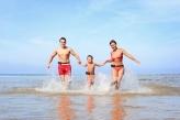 happy family having fun on the beach